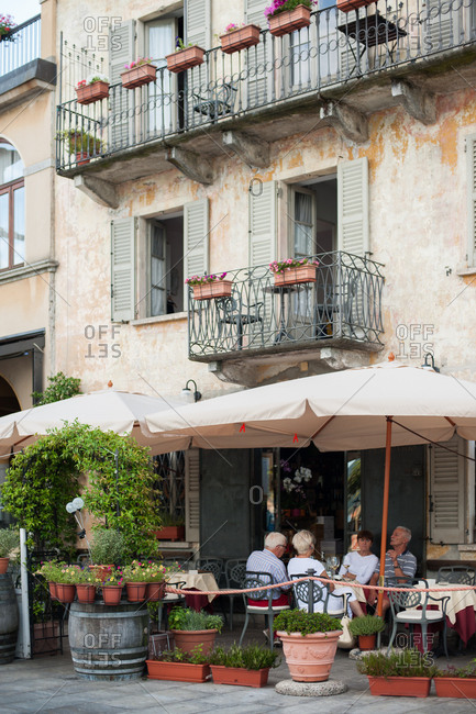 Lake Maggiore, Italy - July 16, 2016: People dining on a restaurant terrace in Italy