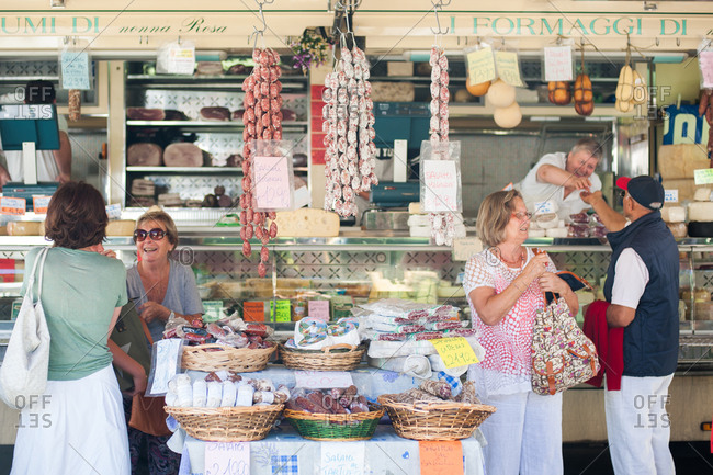 Lake Maggiore, Italy - July 17, 2016: Shoppers buying meat at a market in Italy