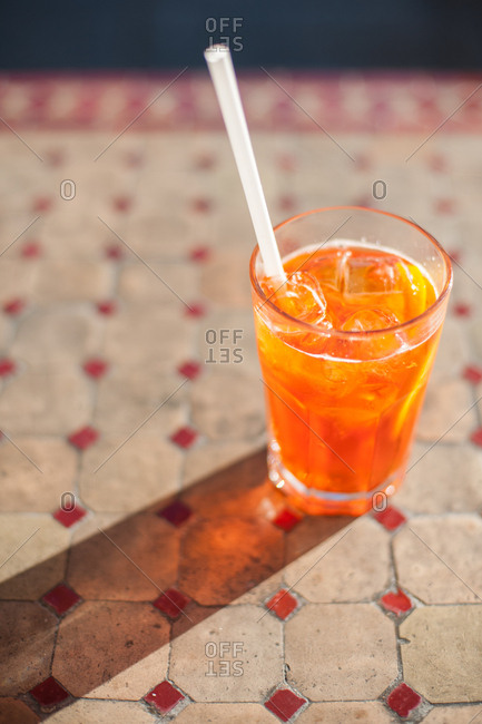 Aperol spritz served with a straw