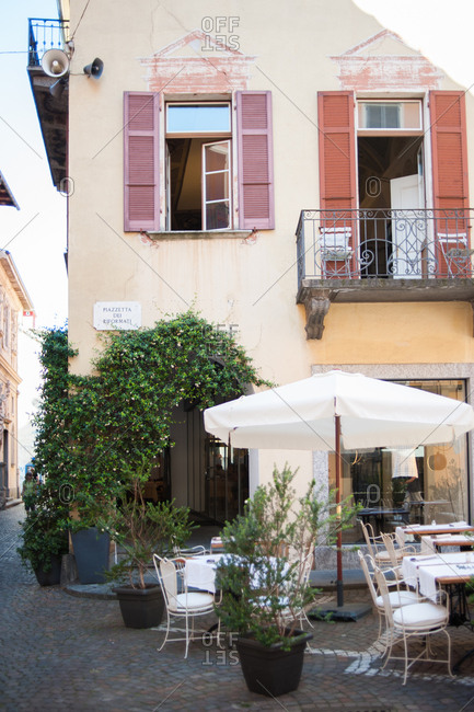 Restaurant exterior with table and chairs in Locarno, Switzerland