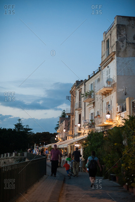 Syracuse, Italy - July 22, 2015: Evening street scene in Syracuse, Italy