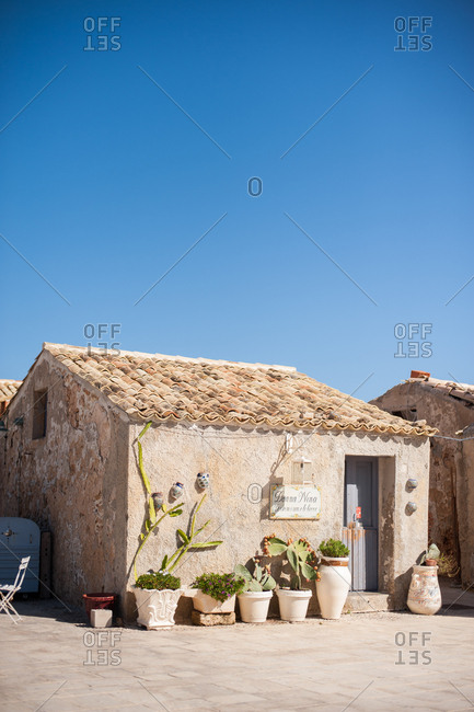 Marzamemi, Italy - July 22, 2015: Restaurant exterior with cactus plants out front in Marzamemi, Italy