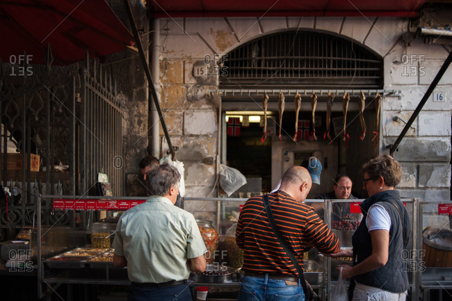 Catania, Italy - July 22, 2015: Rear view of shoppers at a market in Catania, Italy