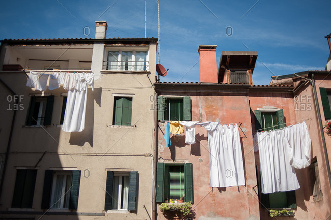 Laundry hanging on lines from buildings in Venice