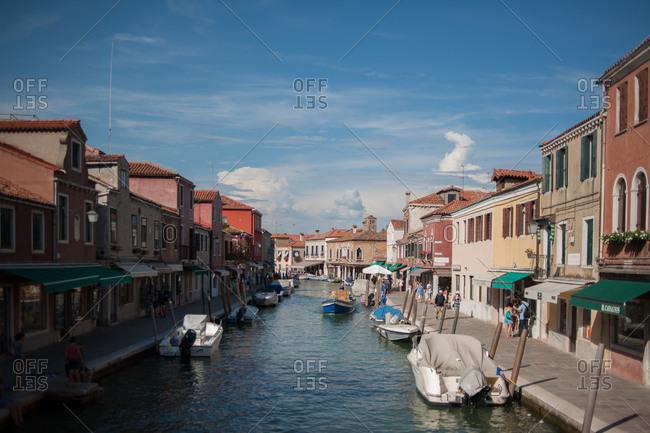 Venice, Italy - July 22, 2015: Boats in the canal in Murano, Venice, Italy