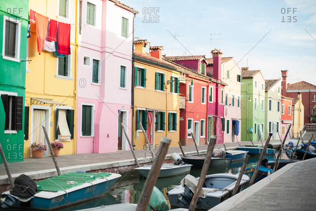 Venice, Italy - July 22, 2015: Colorful houses and boats in a canal in Burano, Venice, Italy