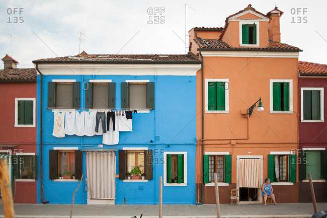 Venice, Italy - July 22, 2015: Colorful homes along the canal in Burano, Venice, Italy
