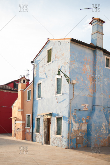 Old blue building in Burano, Venice, Italy