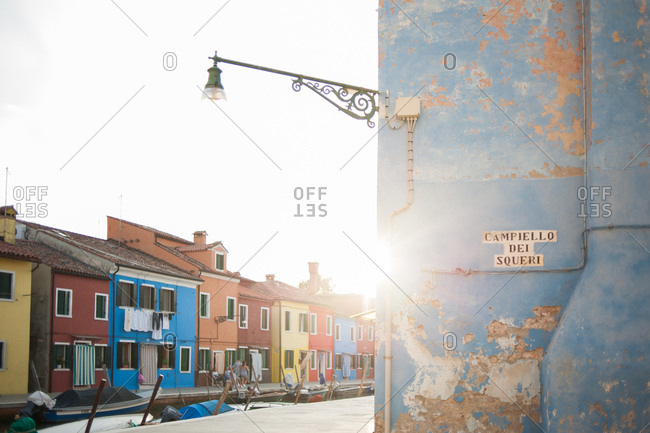 Venice, Italy - July 22, 2015: Old blue building next to the canal in Burano, Venice, Italy