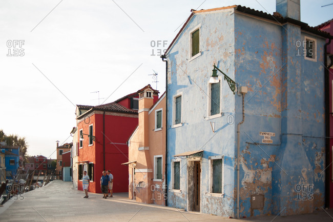 Venice, Italy - July 22, 2015: Colorful old buildings by the canal in Burano