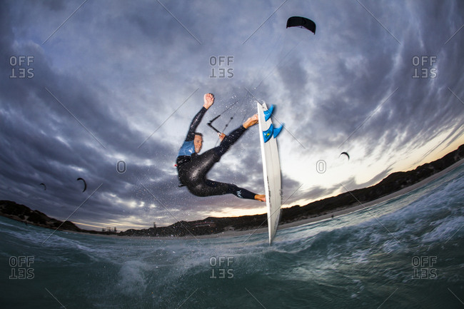 Australia - March 15, 2011: A kite surfer does an aerial as the day turns to night.