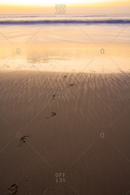 Footsteps lead to the ocean in northern Peru