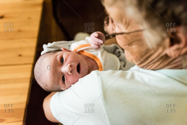 Newborn baby in grandmother's arms