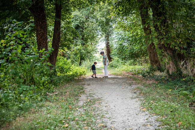 Grandmother and boy on forest path