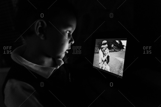 Boy looking at digital photo frame