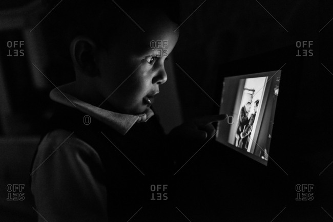 Boy looking at a digital photo frame