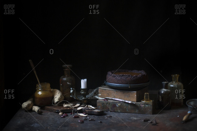Chocolate decadent mud cake with caramel cream and ingredients on a rusty table