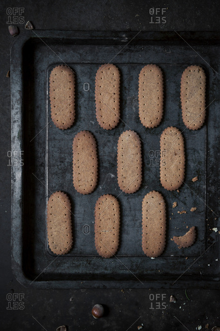 Overhead shot of a baking tray with homemade hazelnut cookies