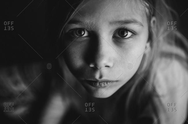 Girl sitting on floor looking up