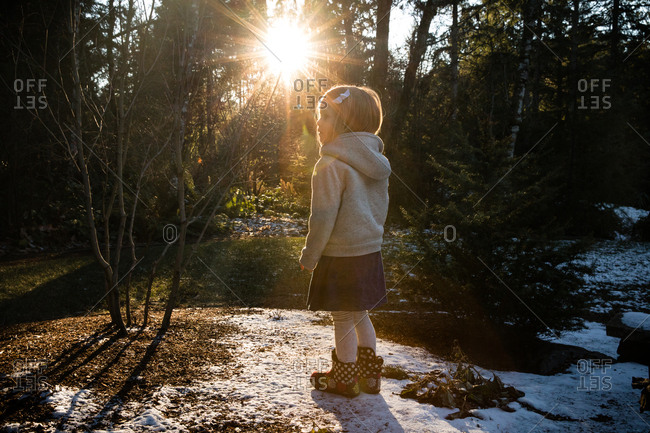 Girl in sweatshirt in forest with snow