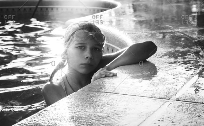 Girl in swimming pool wearing goggles