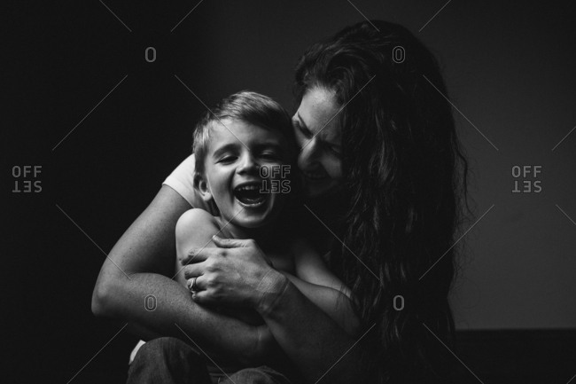 Mom hugging a laughing boy