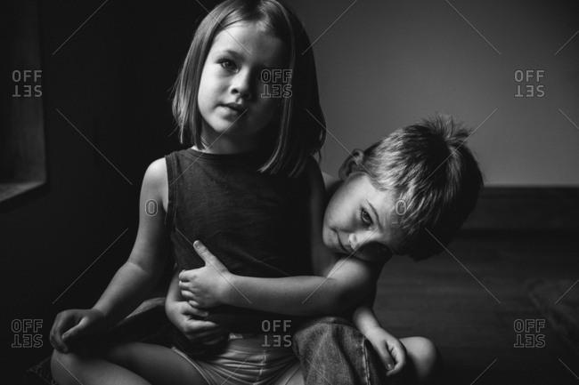 Boy giving a girl a hug