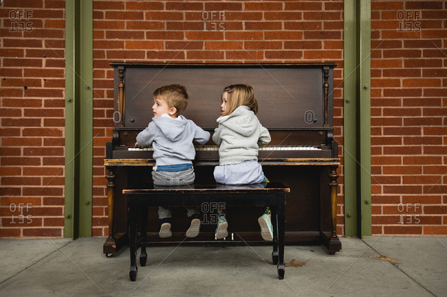 Boy and girl at piano together