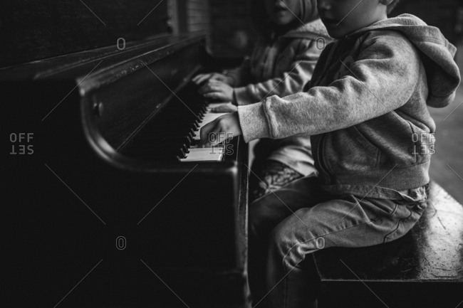 Kids learning to play piano