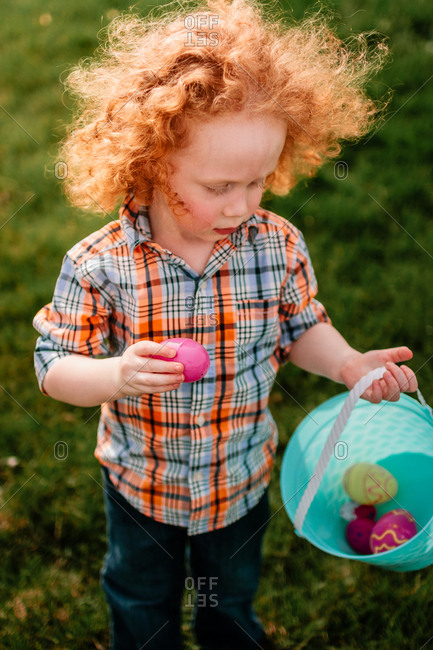 Child collecting Easter eggs