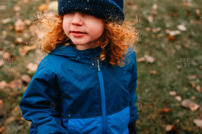 Child in snow with hat too low