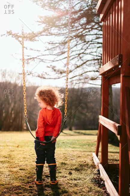Child getting on swing