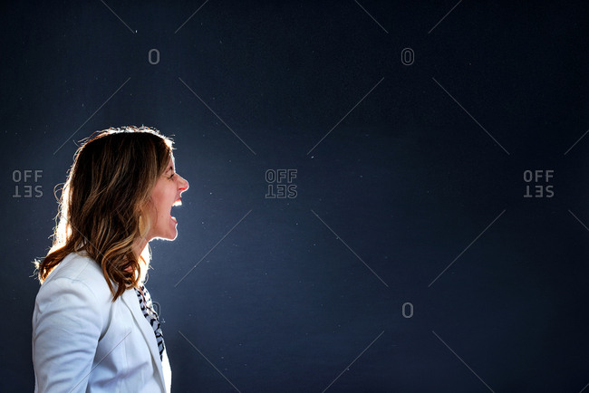 Profile of a woman standing and yelling