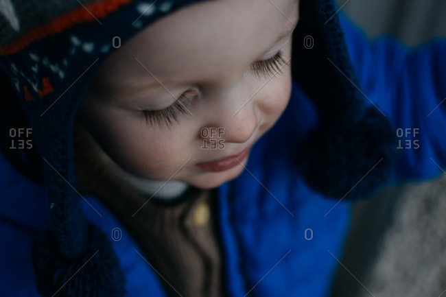 Face of a little boy in a toboggan and coat