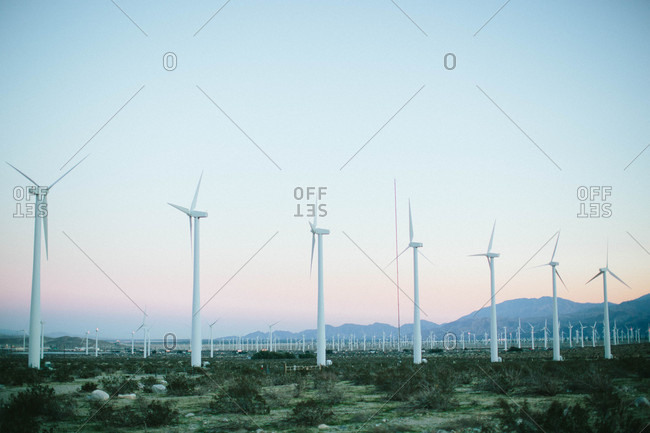 Wind turbines with mountains in the background