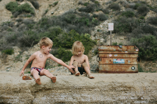 Boys playing on a beach in the sand