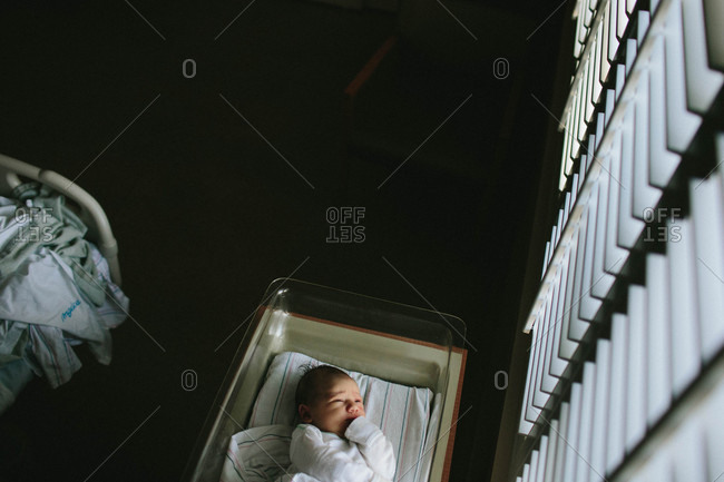 Overhead view of baby lying in a hospital bassinet