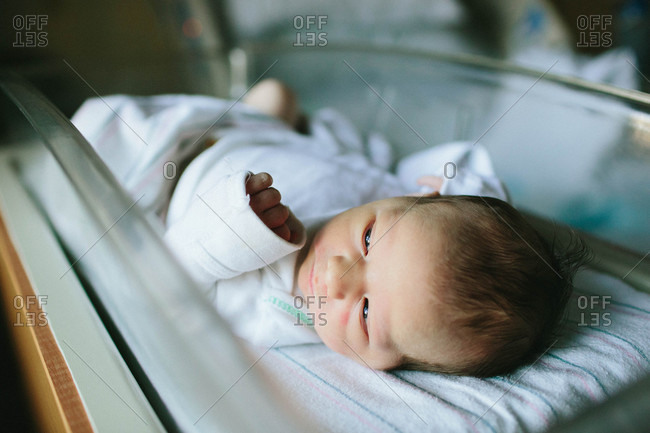Close up of a newborn baby in a hospital bassinet