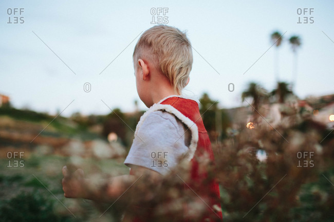 Blonde boy playing in a field