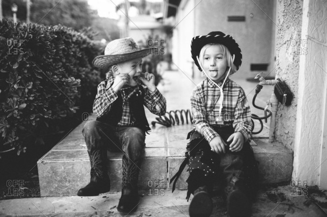 Boys dressed as cowboys for Halloween making silly faces