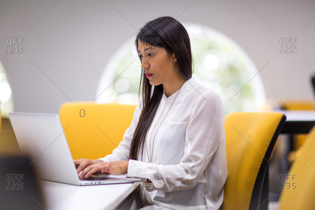 Businesswoman concentrating on laptop screen