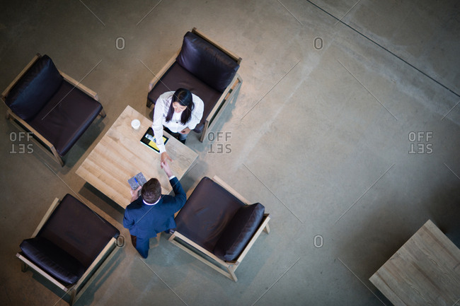 Overhead shot of handshake in a meeting