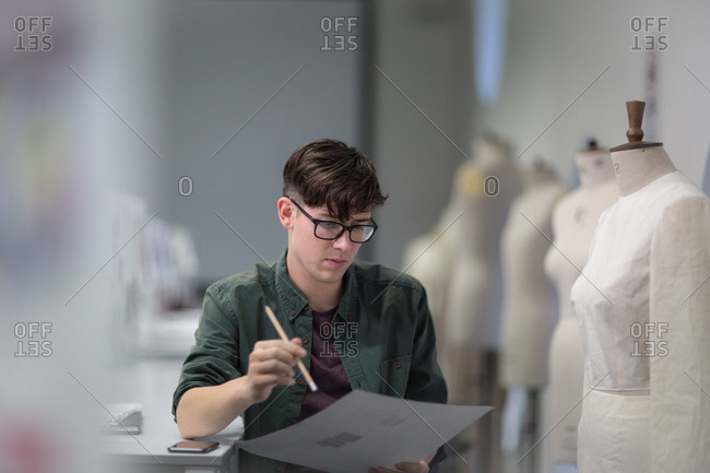 Fashion student drawing a design
