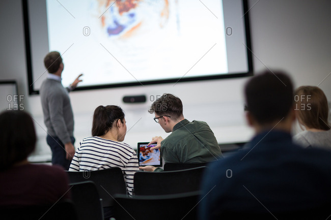 Students using digital tablet at a lecture