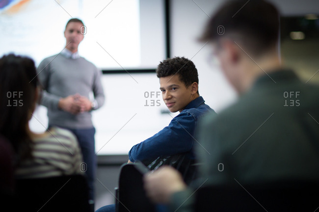 Student listening to a question at a lecture