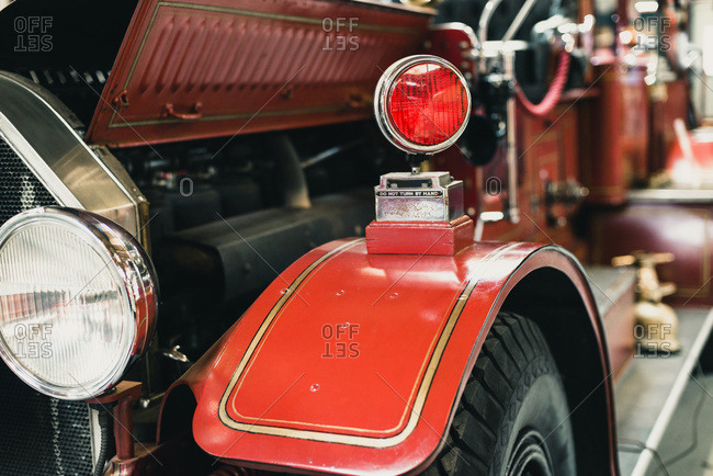 Red signal light on mudguard of old fire truck