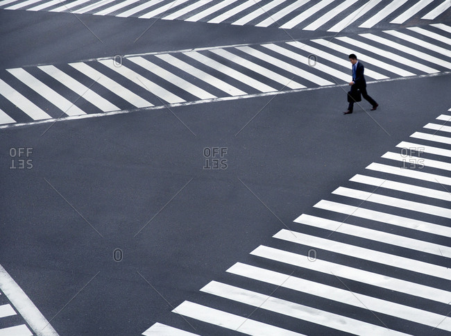 March 5, 2107 - Tokyo, Japan: Businessman rushing to work at Ginza crossing