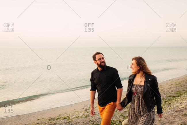 Loving couple strolling on beach