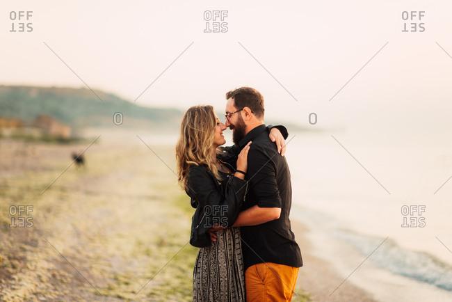 Couple in loving hug on beach