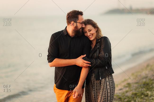 Couple embracing during beach walk